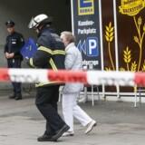 En person er død og adskillige sårede efter et knivangreb i et Edeka Supermarked i Hamburg. / AFP PHOTO / dpa / Paul Weidenbaum / Germany OUT
