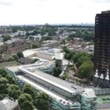 Arkivfoto. På opfordring fra Londons borgmester og efter kritik fra May går leder i byråd af efter Grenfell-brand.