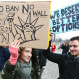 Protesters hold placards during a rally against U.S. President Donald Trump's immigration policies outside the U.S. embassy in Berlin, Germany February 4, 2017. REUTERS/Pawel Kopczynski