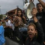 Beboere i Caracas, Venezuela, demonstrerer mod manglen på mad, 14. juni, 2016.