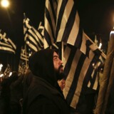 Supporters of Greece's far-right Golden Dawn party take part in a rally at central Syntagma square in Athens November 30, 2013. Hundreds of supporters gathered outside parliament on Saturday to protest the pre-trial detention of their leader Nikolaos Mihaloliakos, who faces charges of forming a criminal organisation. REUTERS/Yorgos Karahalis (GREECE - Tags: POLITICS CIVIL UNREST)