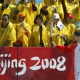 Den olympiske flamme på sin vej til Kina.