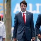 Krise i den canadiske hovedstad, Ottawa. Her ses fra venstre Canadas udenrigsminister, Chrystia Freeland, premierminister, Justin Trudeau, og forsvarsminister, Harjit Sajjan, tilbage i juli.