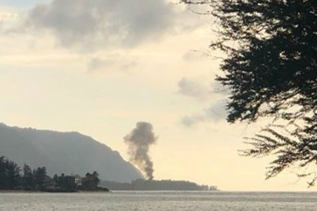 Plume of smoke rises after pla