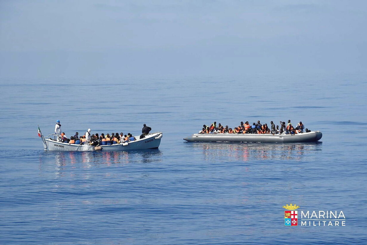 AT SEA MIGRATION REFUGEES RESCUED
