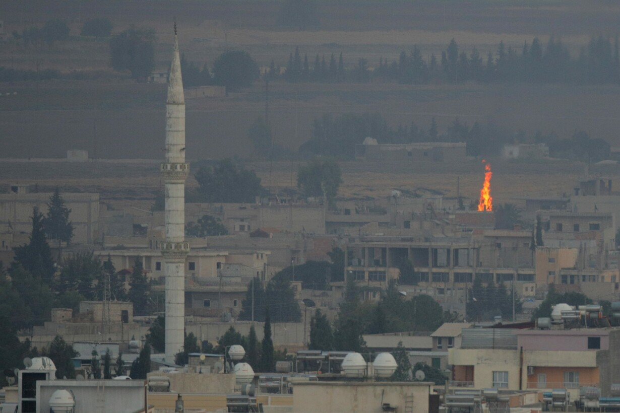Fire is seen in the Syrian tow
