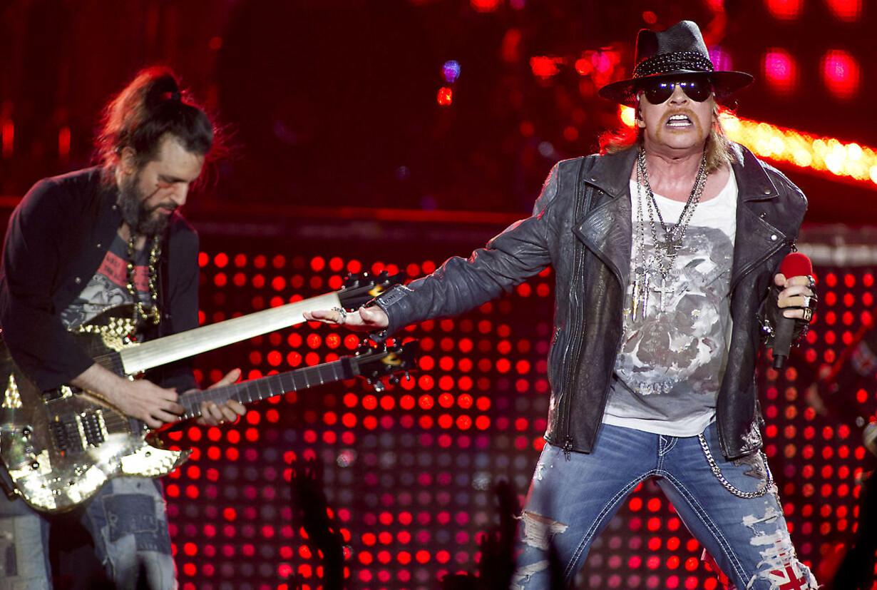 US rockband Guns N' Roses singer Axl Rose (R) performs during a