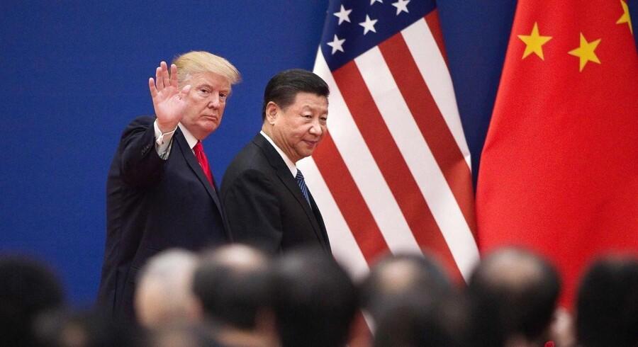 Kina beskylder USA for at starte handelskrig, efter at USA har indført told på kinesiske varer for milliarder. Kina er »tvunget til at tage de nødvendige modforanstaltninger«, oplyser landets handelsministerium ifølge nyhedsbureauet Reuters. (Foto: NICOLAS ASFOURI/Ritzau Scanpix)