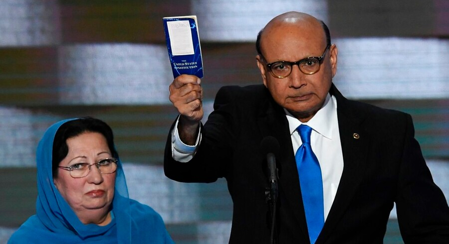 Khizr Khan holds his personal copy of the US Constitution while addressing delegates on the fourth and final day of the Democratic National Convention at Wells Fargo Center on July 28, 2016 in Philadelphia, Pennsylvania. Khizr Khan's son, Humayun S. M. Khan was a University of Virginia graduate and enlisted in the US Army. Khan was one of 14 American Muslims who died serving the United States in the ten years after the September 11, 2001 terrorist attacks. / AFP PHOTO / SAUL LOEB