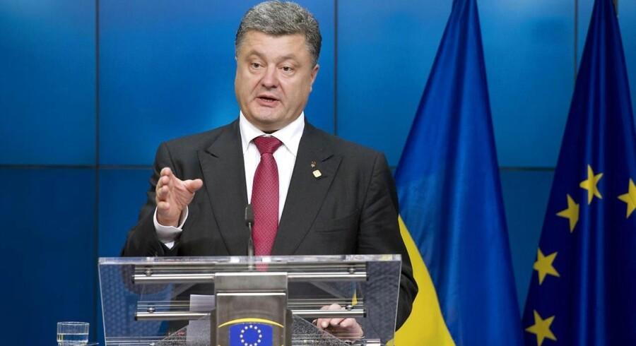 Arkivfoto: Ukranies præsident, Petro Porosjenko, kommer til topmøde med EU-toppen i Bruxelles torsdag. Han er en bekymret mand med en meget lang ønskeliste til EU. AFP PHOTO/ ALAIN JOCARD