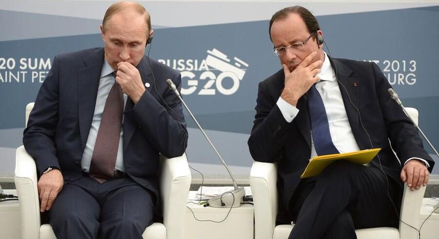 Ruslands præsident, Vladimir Putin, har aflyst sin planlagte tur til Paris næste uge, hvor han skulle være mødtes med den franske præsiden, François Hollande, for at tale om Syrien. På billedet ses de to herrer under et G20 møde i 2013