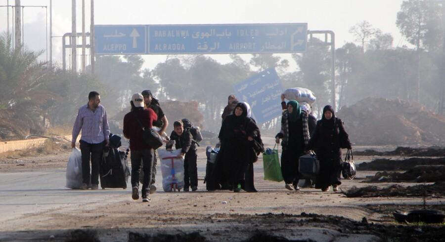 Fredag 4. november fra klokken 9 til 19 kaster de russiske og syriske kampfly ingen bomber over Aleppo, lover Vladimir Putin. Scanpix/Omar Haj Kadour