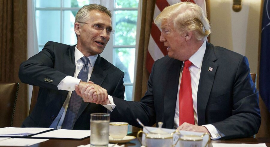 President Donald Trump and NATO Secretary General Jens Stoltenberg shake hands during a expanded bilateral meeting at the White House, in Washington, Thursday, May 17, 2018. (AP Photo/Carolyn Kaster)