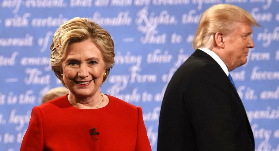 "(FILES) This file photo taken on September 26, 2016 shows Democratic nominee Hillary Clinton (L) and Republican nominee Donald Trump leave the stage after the first presidential debate at Hofstra University in Hempstead, New York. Donald Trump said on November 9, 2016 he would bind the nation's deep wounds and be a president ""for all Americans, "" as he praised his defeated rival Hillary Clinton for her years of public service. / AFP PHOTO / Timothy A. CLARY"