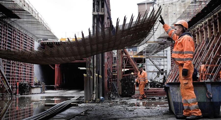 Polske håndværkere i gang med at bygge Nordhavnstunnellen i nærheden af Svanemøllen.