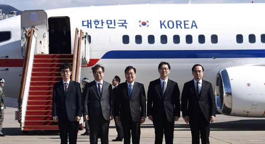 Den sydkoreanske delegation ved afrejsen fra Seoul.