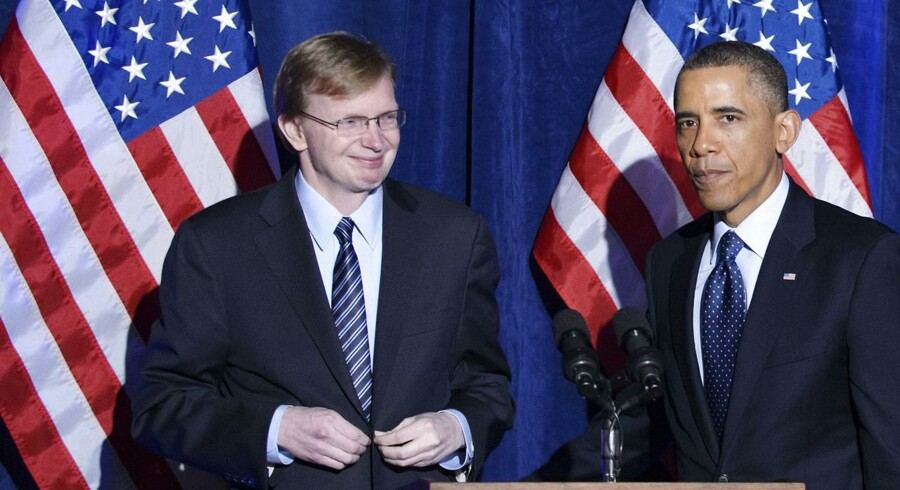 USAs præsident, Barack Obama, taler til en »Organizing for Action«-middag i 2013 på St. Regis Hotel i Washington D.C. med strategen Jim Messina ved sin side. Foto: Mandel Ngan/AFP