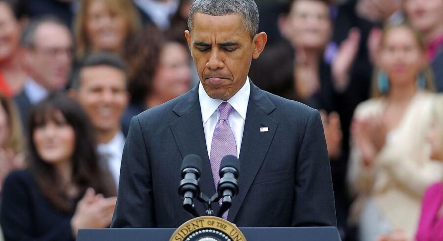Daværende præsident Barack Obana holdt den 23. april 2013 en tale for amerikanske lærere, da Twitter pludseligt gik amok over den falske nyhed, at han skulle være blevet såret af to eksplossioner i Det Hvide Hus. AFP PHOTO/Jewel Samad