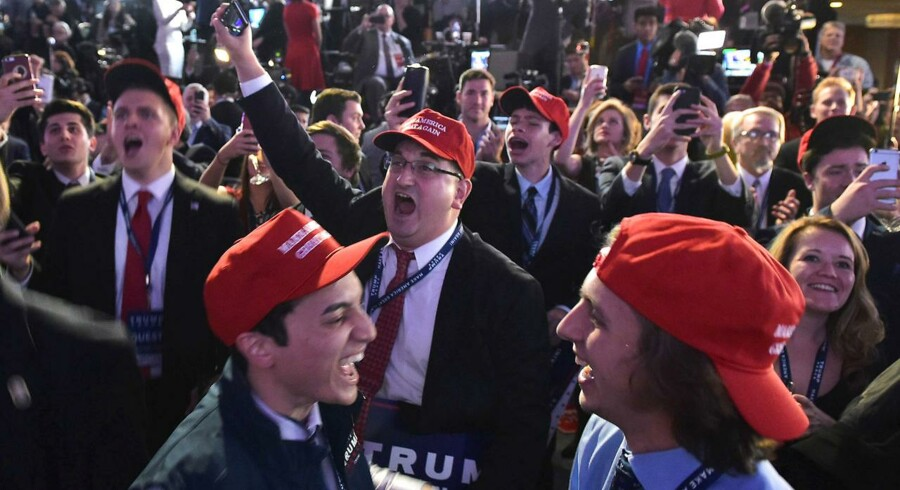 TOPSHOT - Supporters of Republican presidential nominee Donald Trump react to early poll results during election night at the New York Hilton Midtown in New York on November 8, 2016. / AFP PHOTO / Mandel NGAN