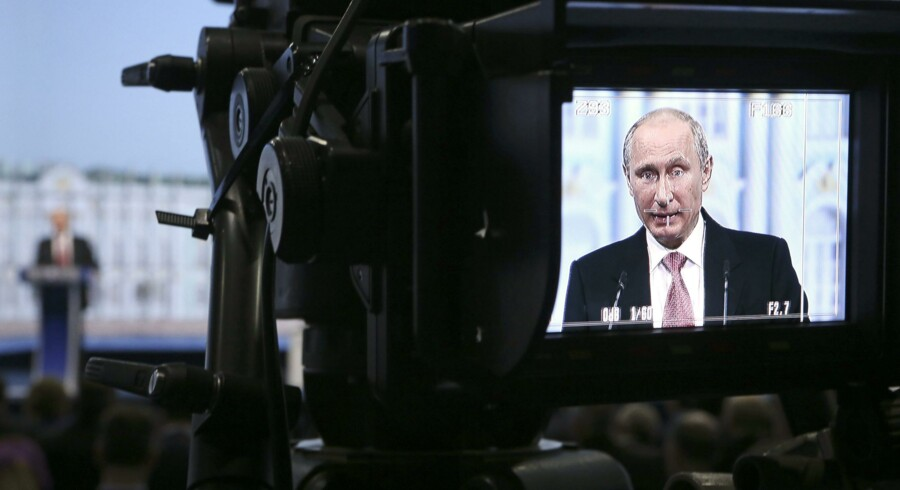 Russia's President Vladimir Putin is seen on a monitor of a camera as he delivers a speech during a session of the St. Petersburg International Economic Forum 2014 (SPIEF 2014) in St. Petersburg May 23, 2014. Putin said on Friday he wanted better ties with the West but fiercely criticised U.S. policy on Ukraine and the global economy - and acknowledged that sanctions were hurting Russia. REUTERS/Sergei Karpukhin (RUSSIA - Tags: POLITICS BUSINESS)
