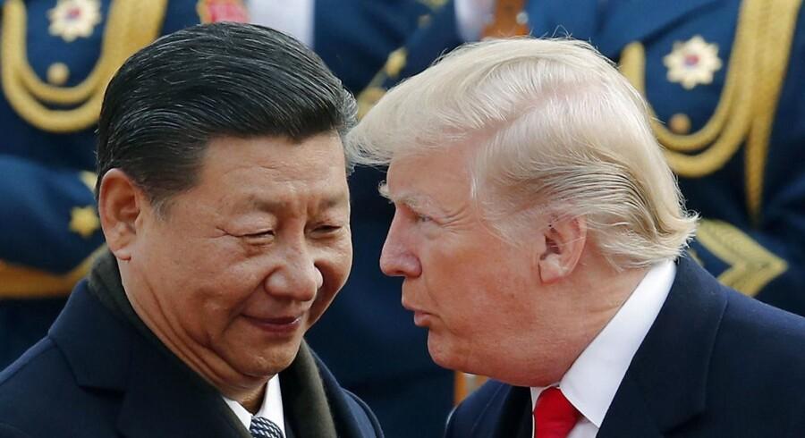 Den kinesiske præsident Xi Jinping og Donald Trump. USA vil torsdag afsløre en række handelssanktioner over for Kina. På forhånd har kineserne sagt, at de vil svare igen, hvis det sker. Det skriver Ritzau, torsdag den 22. marts 2018.. (Foto: Andy Wong/Scanpix 2018)