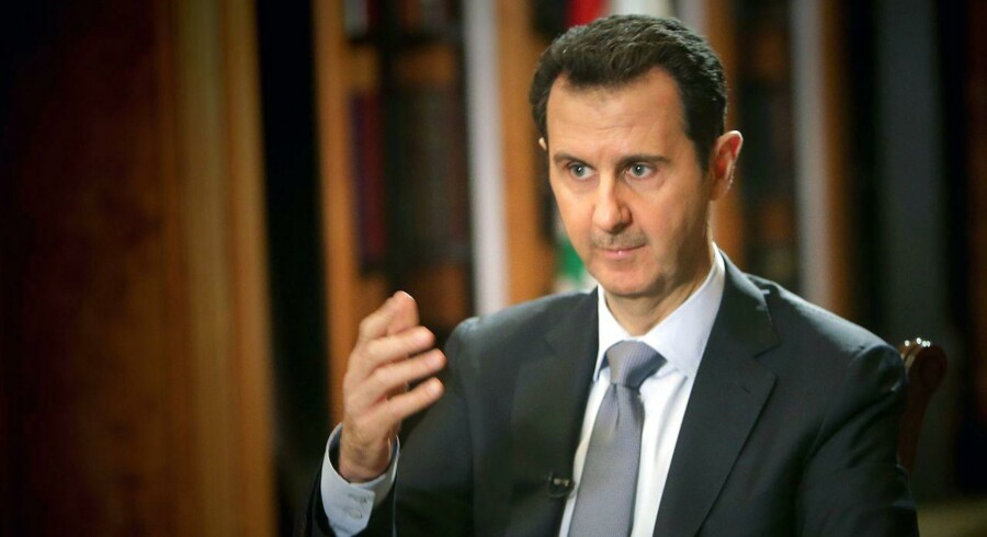 (FILES) This file photo taken on January 18, 2014 shows Syrian President Bashar al-Assad during an interview with AFP in Damascus. / AFP PHOTO / JOSEPH EID