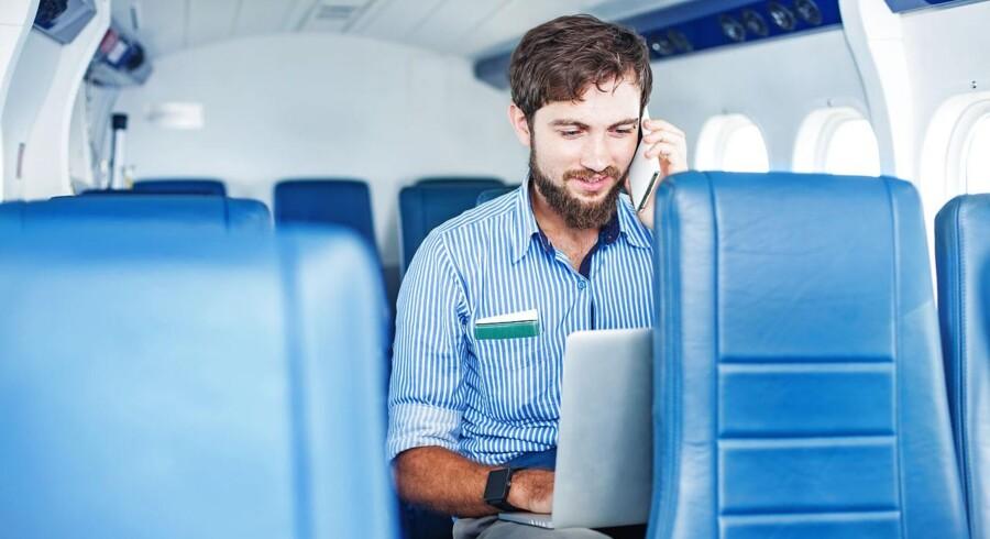 Stadig flere flyselskaber tilbyder passagererne trådløs internetadgang, selv om de hurtige forbindelser stadig er få og kun mod betaling. Arkivfoto: Iris/Scanpix