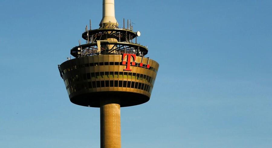 Teleselskaber og internetudbydere - som her Deutsche Telekom - skal alligevel ikke samle oplysninger sammen om tyskernes tale- og internettrafik fra lørdag. Arkivfoto: Wolfgang Rattay, Reuters/Scanpix