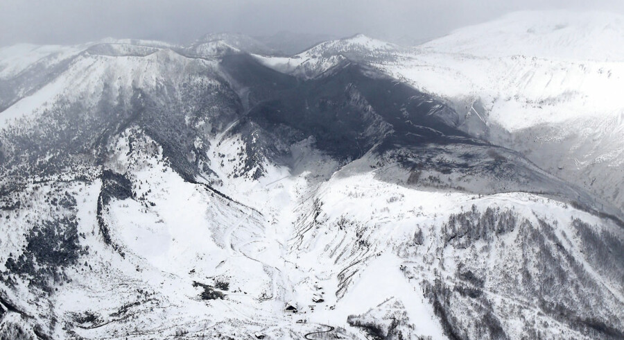 Photo taken from a Kyodo News helicopter on January 23, 2018, shows the area surrounding Mt. Kusatsushirane (top, L) in Gunma Prefecture, northwest of Tokyo, which erupted on the same day. Mandatory credit Kyodo/via REUTERS ATTENTION EDITORS - THIS IMAGE WAS PROVIDED BY A THIRD PARTY. EDITORIAL USE ONLY. MANDATORY CREDIT. JAPAN OUT.NO COMMERCIAL OR EDITORIAL SALES IN JAPAN. TPX IMAGES OF THE DAY