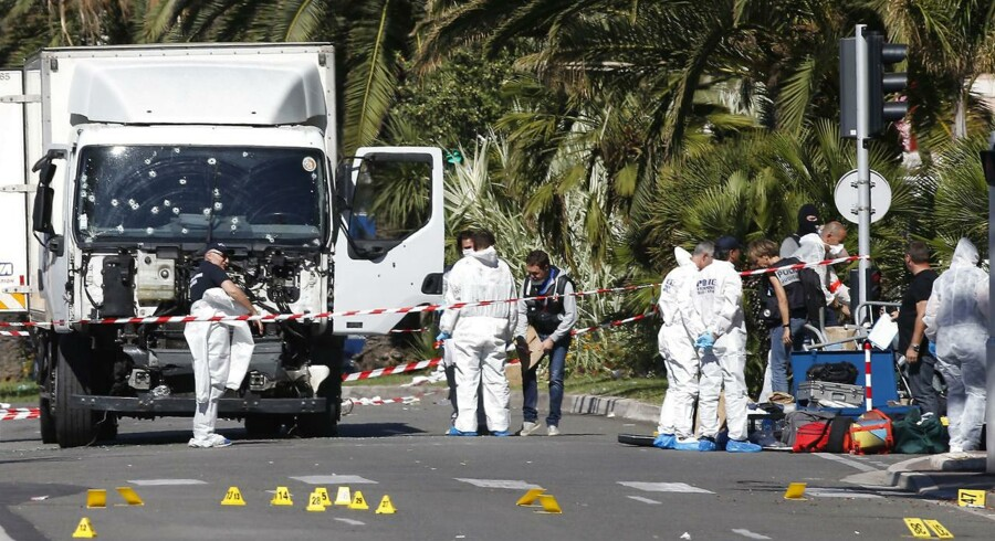 Investigators continue at the scene near the heavy truck that ran into a crowd at high speed killing scores who were celebrating the Bastille Day July 14 national holiday on the Promenade des Anglais in Nice, France, July 15, 2016. REUTERS/Eric Gaillard