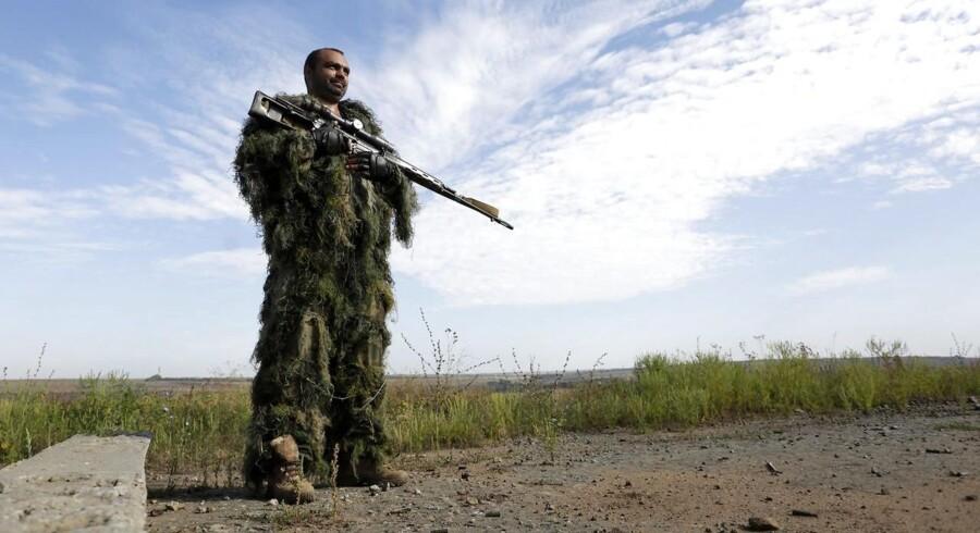 Ukraine og russisk-støttede oprørere begyndte onsdag at gennemføre en udveksling af flere end 300 fanger. AFP PHOTO/ ANATOLII STEPANOV