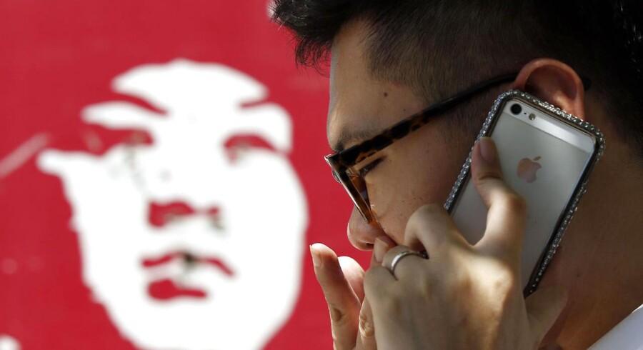 Kinas - og verdens - største mobilselskab, China Mobile, har tilsyneladende en aftale på plads med Apple, som har hårdt brug for at få bedre fat i det vigtige, kinesiske marked. Arkivfoto: Kim Kyung-Hoon, Reuters/Scanpix