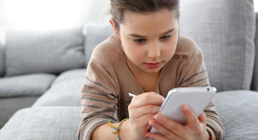 Modelfoto: Facebook har lanceret en ny beskedtjeneste til børn under 13 år, hvor forældre kontrollerer, hvem børnene kommunikerer med.