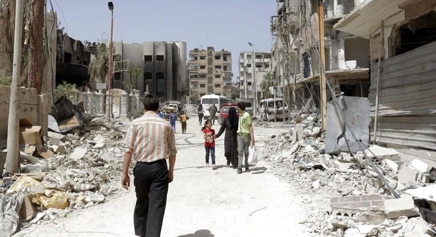Den syriske by Douma. EPA/YOUSSEF BADAWI