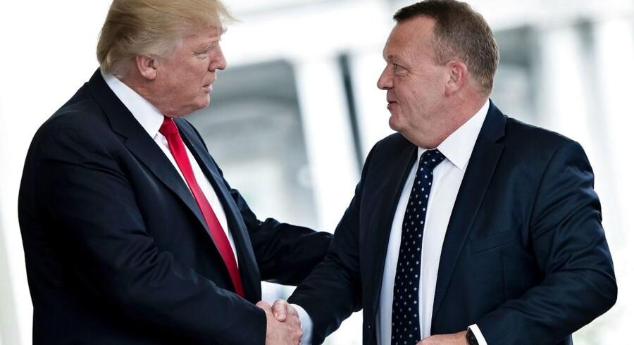 Da var ikke grænser for de lovprisende ord, da præsident Donald Trump tog imod statsminister Lars Løkke Rasmussen i Det Hvide Hus i marts. Nu er forholdet kølnet af. De to er på ingen måder enige om Trumps exit fra Klimaaftalen fra Paris. Be/ AFP PHOTO / Brendan Smialowski