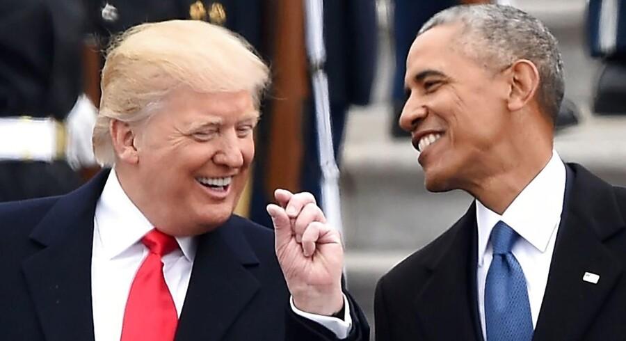 De har kunnet smile sammen - men de deler ikke meget, præsident Donald Trump og hans forgænger Barack Obama. Trump vil ophæve ObamaCare, hvis han kan komme igennem med det. / AFP PHOTO / Robyn BECK