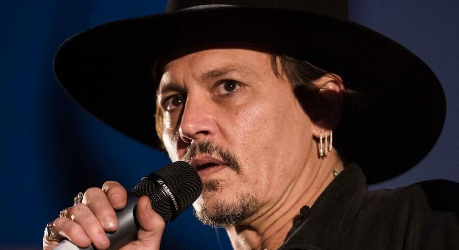 Johnny Depp fotograferet 22. juni ved Glastonbury Kulturfestival i Sydengland. AFP PHOTO / Oli SCARFF