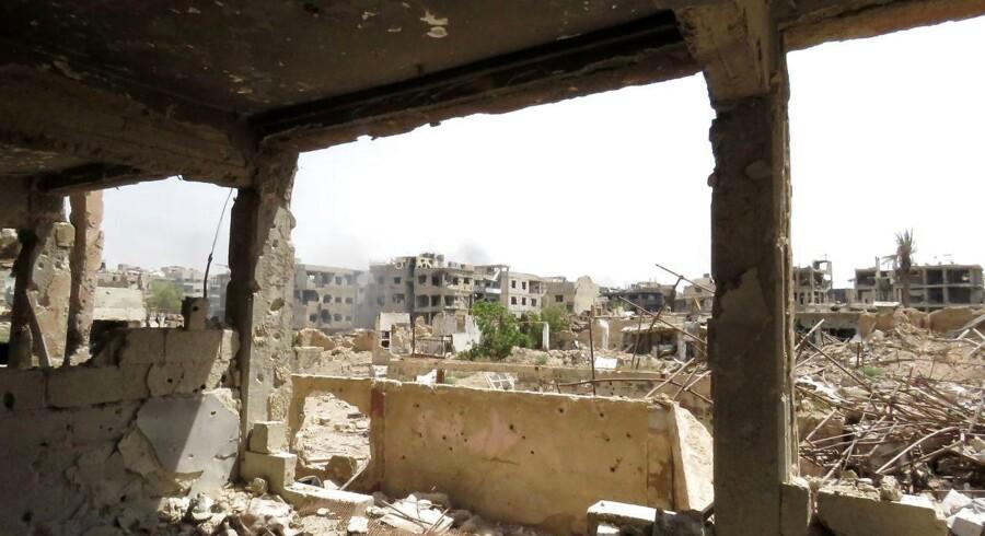 Her ses et billede fra den syriske by Daraya lige uden for Damaskus taget 28, august, som viser de kollapsede bygninger efter en fire år lang belejring.