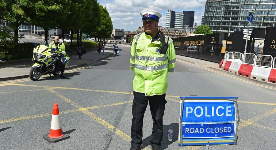 epa05983702 Police cordon off the Manchester Arena in Manchester, Britain, 23 May 2017. According to a statement by the Greater Manchester Police, at least 22 people have been confirmed dead and around 59 others were injured, in an explosion at the Manchester Arena on the night of 22 May at the end of a concert by US singer Ariana Grande. Police believe that the explosion, which is being treated as a terrorist incident, was carried out by a single man using an improvised explosive device (IED), who was confirmed dead at the scene. British Prime Minister Theresa May in the meantime had condemned the incident as 'an appalling terrorist attack.' EPA/ANDY RAIN