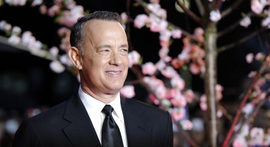 Den amerikanske skuespiller Tom Hanks overraskende i weekenden et nygift par i Central Park. Den berømte skuespiller var ude at løbe, da han så brudeparret, og ville lige ønske tillykke.