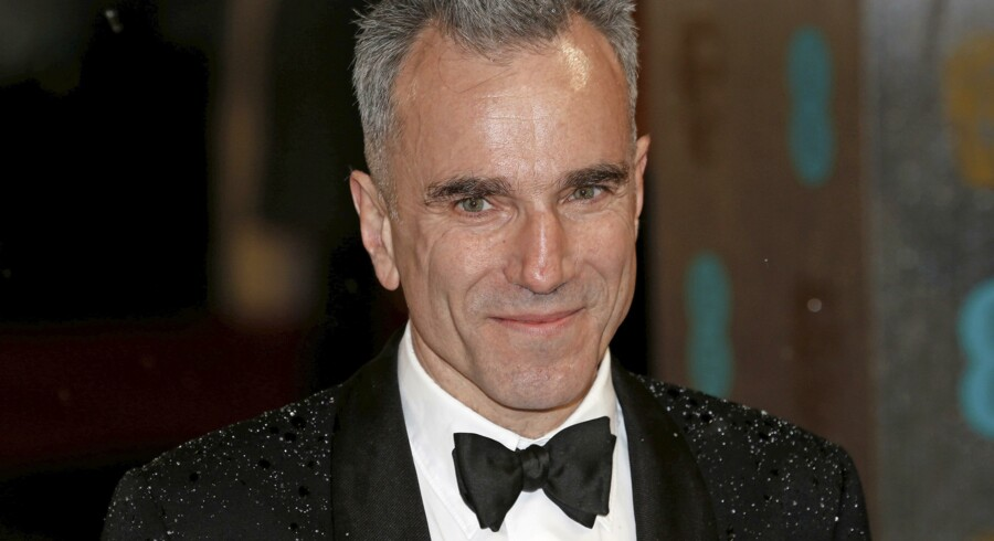FILE PHOTO: Actor Daniel Day-Lewis poses as he arrives for the British Academy of Film and Arts (BAFTA) awards ceremony at the Royal Opera House in London, Britain, February 10, 2013. REUTERS/Suzanne Plunkett/File Photo