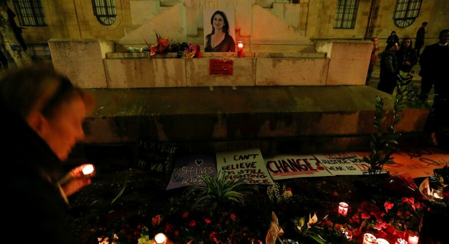 People place candles at a memorial for investigative journalist Daphne Caruana Galizia, who was murdered in a car bomb attack, during a vigil in Valletta, Malta November 16, 2017. REUTERS/Darrin Zammit Lupi