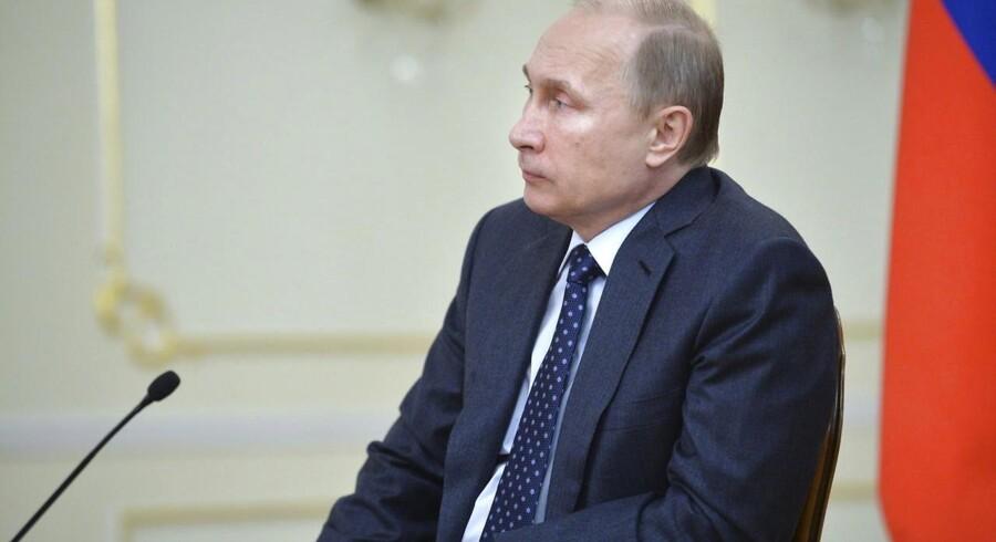 Ruslands præsident, Vladimir Putin, har strammet kontrollen med Internet i landet, og nu trues tre amerikanske giganter med at blive blokeret. Arkivfoto: Alexei Druzhinin, RIA Novosti/Reuters/Scanpix