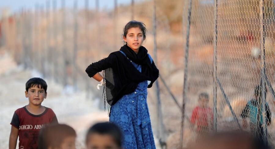Internt fordrevne syriske børn ankommer til en flygtningelejr i Idlib-provinsen i september. Mandag blev Erdogan og Putin enige om at indføre en såkaldt bufferzone i Idlib og udskyde en militær offensiv. Foto: Khalil Ashawi/Reuters