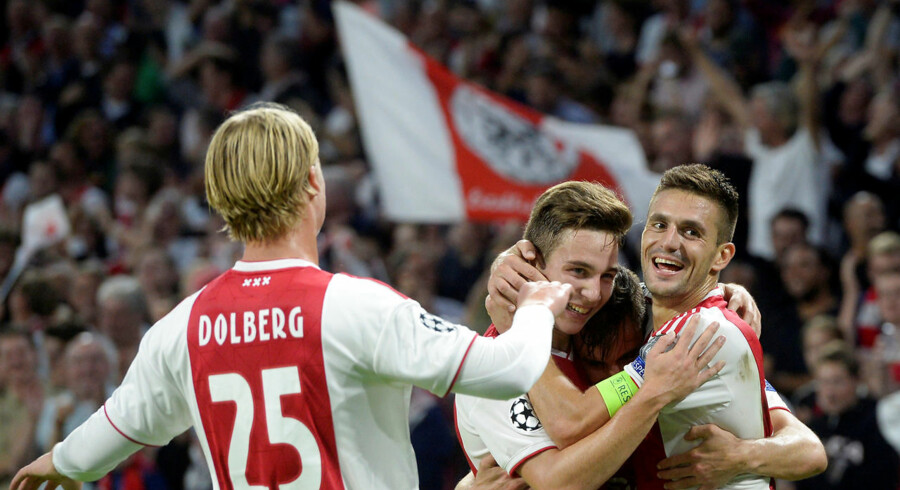 Soccer Football - Champions League - Group Stage - Group E - Ajax Amsterdam v AEK Athens - Johan Cruijff Arena, Amsterdam, Netherlands - September 19, 2018 Ajax's Nicolas Tagliafico celebrates scoring their third goal with Dusan Tadic and Kasper Dolberg REUTERS/Toussaint Kluiters. (Foto: STRINGER/Ritzau Scanpix)