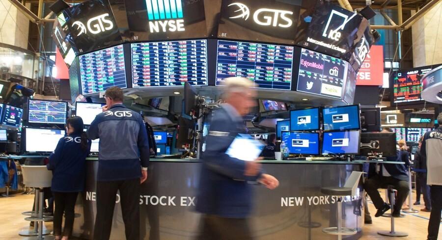 Aktiehandlerne på New York Stock Exchange i NewYork skal til at vænne sig til et nyt investeringsmiljø. Arkivfoto: Bryan R. Smith/ AFP/Ritzau Scanpix