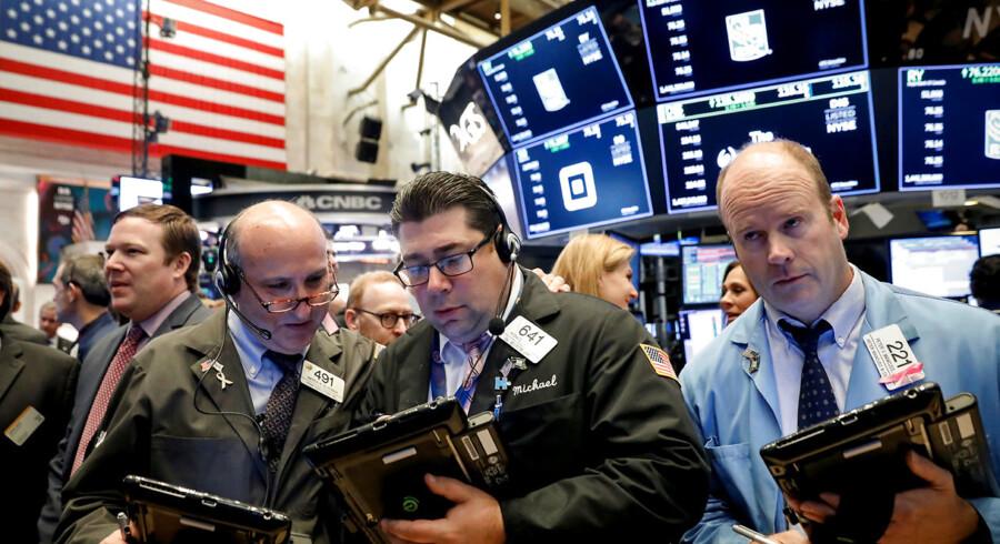 Traders work on the floor of the New York Stock Exchange (NYSE) in New York, U.S., October 16, 2018. REUTERS/Brendan McDermid