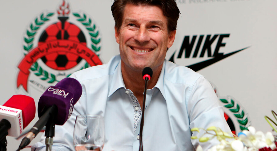 Newly-appointed head coach of Qatar league champions al-Rayyan's football club, Danish Michael Laudrup, smiles during a press conference on October 3, 2016 in the capital Doha. Former Barcelona and Real Madrid star Laudrup replaces Jorge Fossati, who was appointed as coach of Qatar's national team. . KARIM JAAFAR / AFP