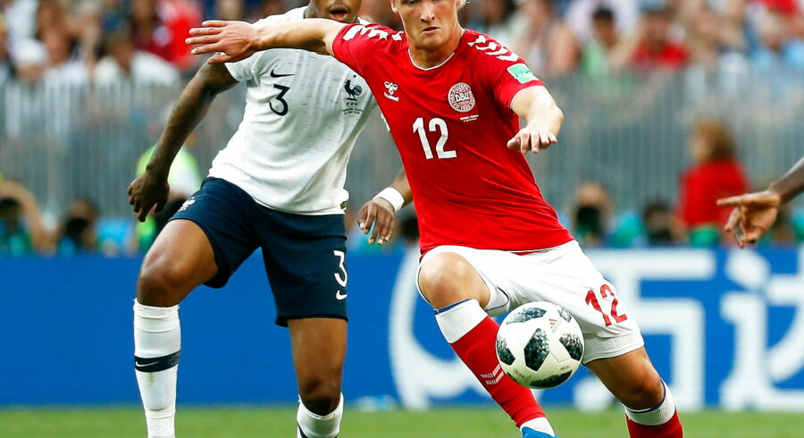 epa06842143 Presnel Kimpembe (L) of France in action against Kasper Dolberg (R) of Denmark during the FIFA World Cup 2018 group C preliminary round soccer match between Denmark and France in Moscow, Russia, 26 June 2018. The match ended 0-0. (RESTRICTIONS APPLY: Editorial Use Only, not used in association with any commercial entity - Images must not be used in any form of alert service or push service of any kind including via mobile alert services, downloads to mobile devices or MMS messaging - Images must appear as still images and must not emulate match action video footage - No alteration is made to, and no text or image is superimposed over, any published image which: (a) intentionally obscures or removes a sponsor identification image; or (b) adds or overlays the commercial identification of any third party which is not officially associated with the FIFA World Cup) EPA/FELIPE TRUEBA EDITORIAL USE ONLY