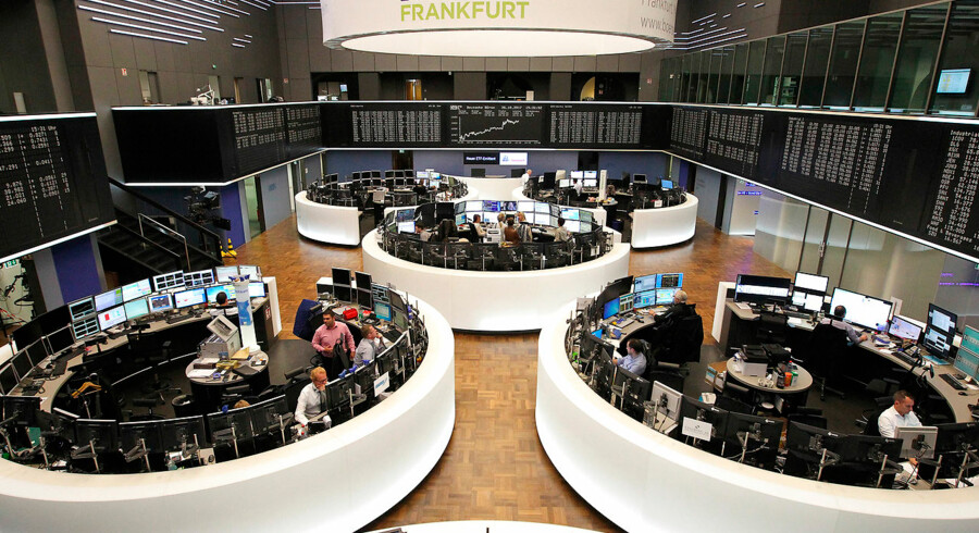 """Brokers work at the stock exchange in Frankfurt am Main, western Germany, on October 26, 2017. Mario Draghi, President of the European Central Bank (ECB) said the eurozone economy still relied on """"an ample degree"""" of stimulus in the face of sluggish inflation. Daniel ROLAND / AFP"""